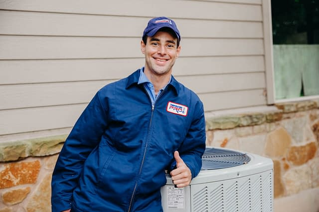 hvac technician with thumbs up
