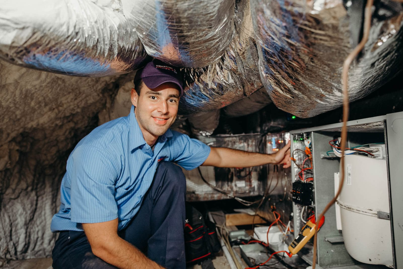 hvac technician conducting a furnace tune up